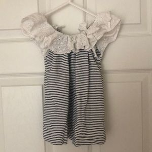 Navy and white striped tank with ruffle neck.